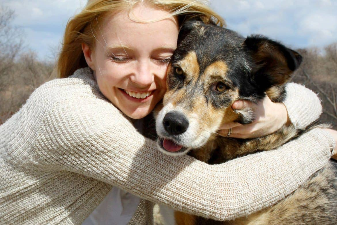 Close up of Woman Hugging German Shepard
